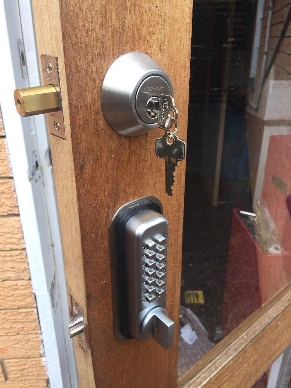 Emergency locksmith brisbane lock fitted to door with key and digilock